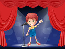 A boy performing on the stage Royalty Free Stock Images