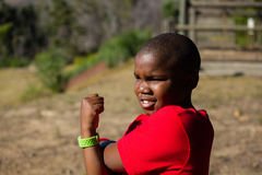 Boy performing stretching exercise during obstacle course training Royalty Free Stock Photography