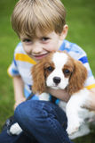 Boy With Pet King Charles Spaniel Puppy Royalty Free Stock Photo