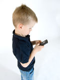 Boy with phone. Young boy is playing with his cellular mobile phone stock photos