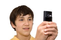 Boy and phone. Boy photographes by the telephone royalty free stock image