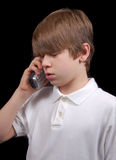 Boy On Phone. This young teen boy is taking a phone call.  Is he receiving good or bad news?  Or is he simply talking to his buddy?  You decide Royalty Free Stock Photography
