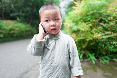 Boy on phone Stock Images