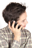 Boy on the phone. Boy talking on mobile phone Royalty Free Stock Photo