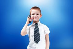 Boy with the phone stock photos