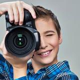 Boy with photo camera Royalty Free Stock Photos