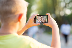Boy photographed on a smartphone Stock Photo