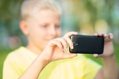 Boy photographed on a smartphone Royalty Free Stock Photos