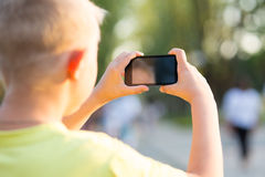 Boy photographed on a smartphone Royalty Free Stock Image