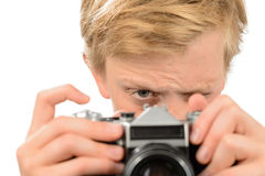 Boy photographing with retro camera Stock Photo