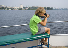 Boy photographing on the ship Stock Photography