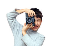 Boy photographing vertical with black slr camera Stock Photography
