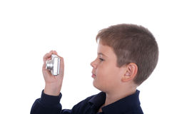 The boy photographs the camera. On a white background Royalty Free Stock Photo