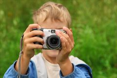 Boy photographs outdoor Stock Images
