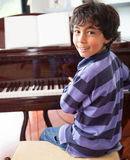 Boy the piano Stock Images