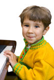 Boy and piano Royalty Free Stock Photos