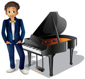 A boy beside the piano Stock Photo