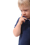 Boy picking his nose Stock Photo