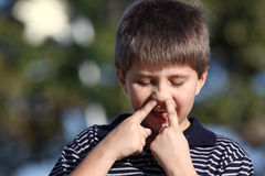 Boy picking nose. Young child smiling and picking his nose Stock Photo