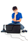 Boy picks a laptop or joystick Stock Image