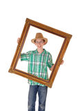 Boy with picture frame. Royalty Free Stock Image