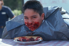 Boy at pie eating contest Royalty Free Stock Images