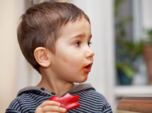 Boy with a piece of pepper Stock Photo