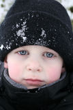 Boy piercing look in snow Royalty Free Stock Photography