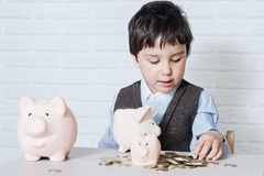 Boy with pig piggy bank Stock Photography