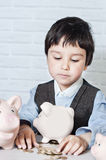 Boy with pig piggy bank Royalty Free Stock Image