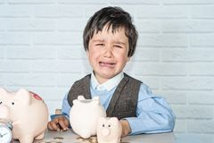 Boy with pig piggy bank Royalty Free Stock Images