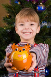 Boy with piggy bank Stock Photography