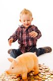 Boy with piggy bank Stock Photos