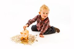 Boy with piggy bank Royalty Free Stock Images