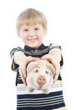 Boy with piggy bank. Happy boy with piggy bank isolated on white Stock Photo
