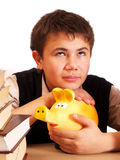 A boy and a piggy bank Stock Image