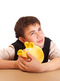 A boy and a piggy bank Royalty Free Stock Images
