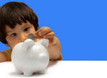 Boy with piggy bank royalty free stock image