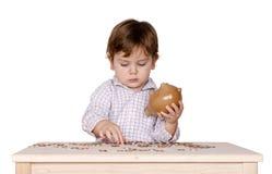 Boy with a piggy bank. Stock Photos