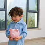Boy piggy bank royalty free stock photography
