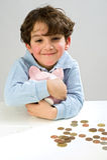 Boy piggy bank. Young boy holding a piggy bank Stock Images