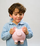 Boy piggy bank. Young boy holding a piggy bank Stock Photo