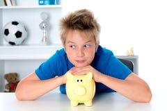 Boy with piggy-bank Stock Photos
