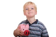 Boy with piggybank. Portrait of a young boy holding his pink piggybank royalty free stock photos