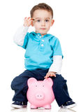 Boy with a piggybank Stock Photography
