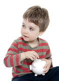 Boy with piggybank Royalty Free Stock Photo