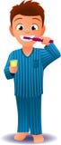 Boy in pijamas brushing his teeth Royalty Free Stock Photo