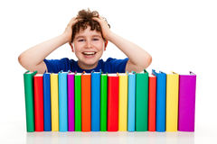 Boy and pile of books Stock Image