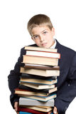 The boy and a pile of books Royalty Free Stock Photos