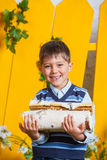 Boy with pile of firewood Stock Photo